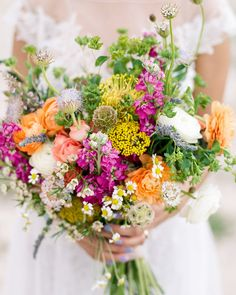 Atalia's bridal bouquet was a lively gathering of wildflowers and greenery by Blush and Vine—including ranunculus, spray roses, scabiosa, chamomile, yellow rice flower, and fresh lavender.