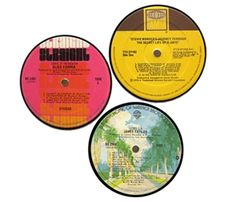 Vintage vinyl record magnets are made from original vintage record labels. These feature a super-strong rare earth magnet fitted into the spindle hole, allowing for two-sided display. Set of 3, assorted vinyl label coasters. www.hatchecolifestyle.com