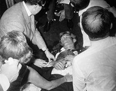 Clutching his rosary beads, Senator Robert F. Kennedy lies wounded on the floor of the Ambassador Hotel, after being shot by an assailant following his victory speech in the California primary election on June 5, 1968, and dies one day later from his injuries. Kennedy's wife Ethel is at lower left. Palestinian immigrant Sirhan Sirhan was arrested at the scene and later convicted of the murder.