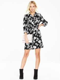 V by Very Printed Shirt Dress - Monochrome Every well-edited wardrobe needs a shirt dress - this printed one from V by Very is just the thing. With button-back sleeves and a smart collar, its fluid silhouette is given a touch of structure with a belted waist for an hourglass-illuminating impact. We love the all-over florals, too. Styling Ideas Pair with chunky block heeled ankle boots and a clutch or tote bag, depending on the occasion. Hello, you!Material Content: 100% Polyester