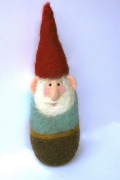 @Donna Olander...you could felt these! Little gnome by Laleebu. Waldorf inspired, needle felted gnome, would fit in with many a festive decorative theme.