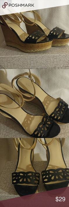 Nine West Women's black/tan wedge shoes Nine west black and tan sandal wedge heel.  Ankle straps worn once.  Platform on toe is 1.5 inches and heel is 4.25 inches. Nine West Shoes Wedges