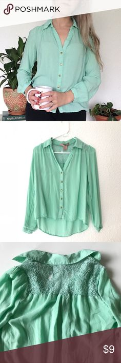 Forever 21 Mint Lace Blouse Pre-loved and in good condition, this F21 button up mint green blouse features brass-colored buttons and lace panel detailing on the back. Blouse is slightly cropped. Perfect for a casual day at work or for lounging around the house. Button on right cuff is missing but can be replaced easily enough if you're handy with a needle (reflected in price, see last pic). Size S. Forever 21 Tops Button Down Shirts