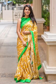 Yellow the uplifting color of happiness, and optimism, of enlightenment and creativity, sunshine and spring! We are tripping on this fresh and funky geometric print satin saree, with delicate thread and sequin work. An equally fresh green border puts the finishing touches on this marvelous drape.A yellow blous a green blouse or even an ivory colored blouse to stay true to the look. #yellow #mustard #satin #geometric #saree #India #blouse #houseofblouse