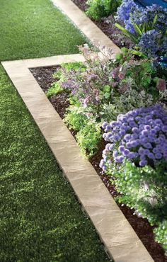 The stone border gives this garden walkway lots of pretty definition, reuse patio bricks to border backyard flower beds