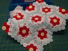 """Mini Flower Garden by scrapnchick, via Flickr made with 1/2"""" hexies"""