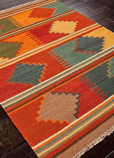 Anatolia Area Rug -  This collection of 100% wool flatweave area #rugs are a beautiful focal point for a southwest or western room!  These colorful rugs add a contemporary twist to your decor. Buy at Lights in the Northern Sky www.lightsinthenorthernsky.com