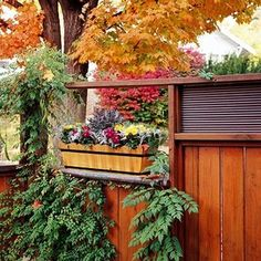 Reinvent a Window Box.Lend color texture and interest to a wood privacy fence by creating a niche for a window box planter. This cedar planter complements the wood fence and provides seasonal color in this corner of the yard. Garden Fencing, Lawn And Garden, Home And Garden, Outdoor Life, Outdoor Gardens, Outdoor Living, Outdoor Ideas, Wood Privacy Fence, Cedar Planters