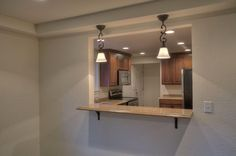 Remodeled Kitchen With Pass-Through Window For Entertaining Ease
