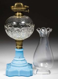 Lot: OWL AND SHIELD KEROSENE STAND LAMP, Lot Number: 0479, Starting Bid: $80, Auctioneer: Jeffrey S. Evans & Associates, Auction: 18th & 19th Century Glass & Lighting, Date: May 18th, 2016 EDT