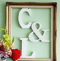 Buy letters at Michaels; paint and frame for kitchen or hallway