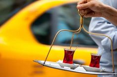 """A cayci, or teaboy, carries a tray with tea to customers near his tea shop in Istanbul, Turkey. Turkish tea (a black tea called """"cay"""") is traditionally consumed in Turkey as the main social beverage as well as offered as a sign of hospitality before or after a meal. #scene"""
