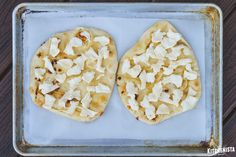 An elegant savory flatbread appetizer loaded with sweet caramelized onions, thinly sliced pears and creamy brie cheese, all drizzled with honey and baked in the oven.
