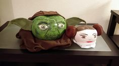 Starwars Halloween pumpkins! Partially carved and painted Yoda and Princess Leia pumpkins. I was just walking through the pumpkin patch and saw a white pumpkin shaped like yoda' s head haha. I used a picture online and just carved out the areas of his face that were shadowed in the picture then painted from there. His ears are made with 2 felt sheets with wire in between, used to keep the ears upright and to embed onto the pumpkin. Princess leia was easier, just cover 2 smaller pumpkins with…