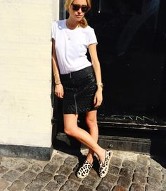 21 Fashion Bloggers With the Most Stylish Tattoos - Look de Pernille's ankle tattoo looks great with her leopard print slip on shoes