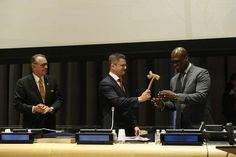 Outgoing United Nations General Assembly President Vuk Jeremic (centre) hands over gavel to incoming President John Ashe of Antigua and Barbuda. Deputy Secretary-General Jan Eliasson is at left.  UN Photo/Evan Schneider