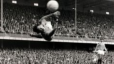Circa 1967. Stoke City goalkeeper Gordon Banks makes a spectacular saved watched by team mate Alex Elder.