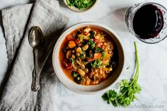 Smoky White Bean Kale and Wheat Berry Stew is quick to pull together with a long, slow simmer. Vegan