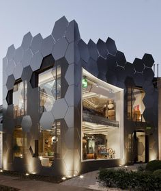This honeycomb inspired facade, full of hexagonal shapes, was created for the…