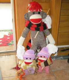 So he finally comes home dragging along these two - like we need more sock monkeys in the house.  Tia and Pip - nuthin' but trouble.