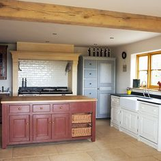 Kitchens: Exposed Timber Kitchen with Red Kitchen Island also White Cabinetry plus Tile Backsplash and Black Countertops
