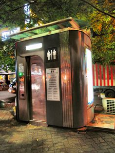 a public restroom that is also a time machine!only in Seoul, South Korea Popular Woodworking, Woodworking Plans, Restroom Design, Kiosk Design, Public Bathrooms, Toilet Design, Street Furniture, Gas Station, Amusement Park