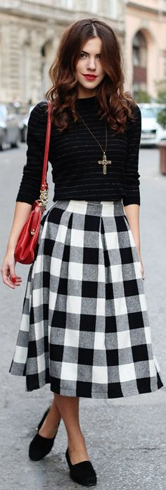 street chic style - office wear - work outfit - business casual - black and white checkered pleated midi skirt + black flats + black long sleeve top + red messenger bag + statement necklace