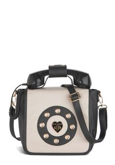 Betsey Johnson Collect Calls Bag. You give a new meaning to accessorizing with rings when you style this vegan faux-leather purse byBetsey Johnson with your tied-neck blouse and flared trousers!  #modcloth