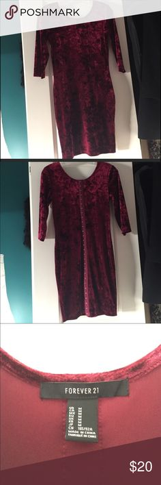 Forever 21 Burgundy fitted dress. Never worn dress. Beautiful color dress. Scoop neck with 3/4 length sleeves. Back of dress has corset closure all the way down the back. Very sexy and classy. Pair with heels for a date night or with black stockings, booties and a leather jacket for a fun night out. Would hate to see this dress go to waste. Forever 21 Dresses Mini