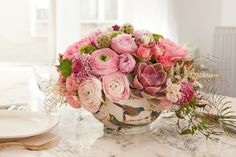 A base of floral foam helps these bursting rosy blooms stand at attention, but a grid of clear tape can also help steady the flowers as you arrange them. - GoodHousekeeping.com