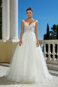 Romance is created within this illusion bodice ball gown. Tonal beading and Venice lace adorn the dress. With a Chantilly lace underlay, this look is both sexy and beautiful. This style is also available with the bodice lined to the back.