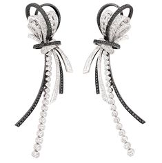 """CHANEL 1932 """"Couture"""" earrings in 18ct white gold, set with 274 round-cut white diamonds totalling 2.5ct, 16 baguette-cut white diamonds of 1.5ct and 236 brilliant-cut black diamonds weighing 1.5ct."""