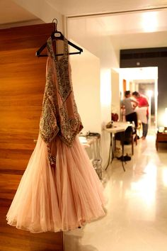 The brides' Sangeet outfit. themarriedapp.com hearted  <3