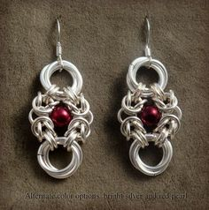 Romanov Earrings in Silver and matte red pearl, via Etsy.  Love these!