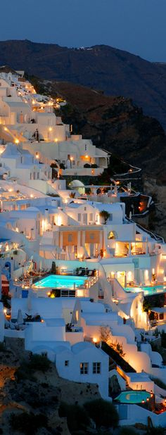The gorgeous crescent shaped Santorini ~ Greece's most popular island with ancient cities, great beaches, amazing food and spectacular scenery.