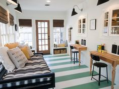 Fixer Upper - baby blue cottage - sun porch playroom - nice green white striped floors (outdoor paint), black and white daybed, black gooseneck sconces, crisp white walls