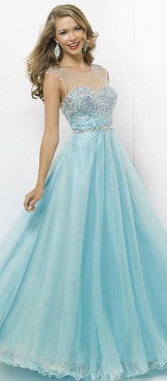 Light blue floor length dress with sweet-heart bodice and 't-shirt' like sleeves with sequin design.