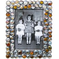 Diane Markin's hand made Bubble Frame, a fun and funky display for all your favorite memories. A variety of colors and shapes are available at fusionartglass.com.