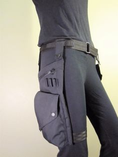 Water Resistant Pocket Belt and Leg Bag. Back to Black. $144.00, via Etsy. - I can't help but wonder how it would be to wear the leg strap with nothing under it.