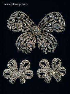 """Three bows in diamonds mounted in gold and silver, created by Jeremie Pauzie, jeweller to Catherine the Great (who also created the coronation regalia to her command). --Prince Michael of Greece, Jewels of the Tsars""""(Diamond Fund)"""