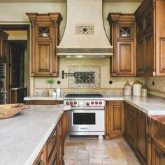 In the kitchen, the taupe-colored backsplash tile, the cabinetry, the farmhouse-style sink and the limestone flooring were existing, but white quartzite counters from Walker Zanger enliven and update the space. Backsplash With Dark Cabinets, Paint Backsplash, Backsplash Cheap, Travertine Backsplash, Beadboard Backsplash, Herringbone Backsplash, Kitchen Backsplash, Hexagon Backsplash, Dark Countertops