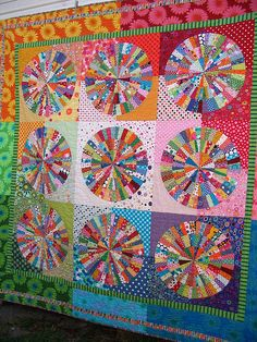 """Foundation pieced Quilt based on pattern in """"Quilts with a Spin"""" by Becky Goldsmith and Linda Jenkins. Most fabric in this quilt is printed with spots, which I slowly collected over a number of years. by Red Pepper Quilts"""