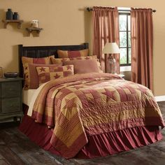 Ninepatch Star Quilt and Bedding by VHC Brands alternates large burgundy stars with burgundy and khaki multi fabric blocks. Reverses to solid khaki fabric.