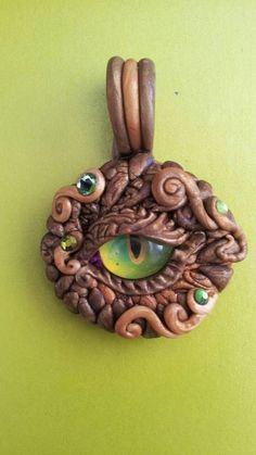 Small Dragon Eye Pendant by MakoslaCreations on Etsy, $20.00