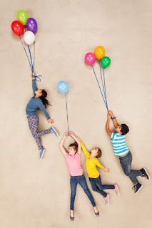 Online Photography Jobs - The helium in these balloons must be pretty strong as its making the children float up into the sky Photography Jobs Online