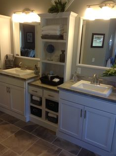 His and Her master bath sinks and storage.