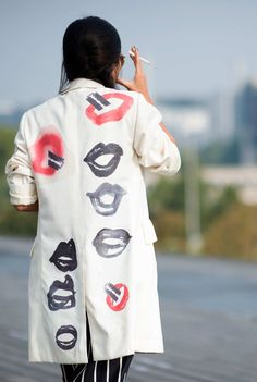 Sarah Chavez Red lips and razor blades: exactly the type of vaguely menacing printed jacket you need to for epic street-style battles.  Photo: YoungJun Koo/I'M KOO