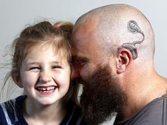 A New Zealand father has gotten a cochlear implant tattooed on his head to help his six year-old daughter not feel like the odd one out...How sweet!
