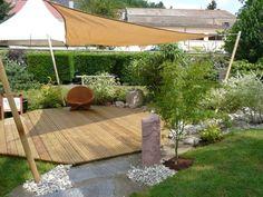 jardin feng shui aménagé avec galets, accents en bambou et plantes