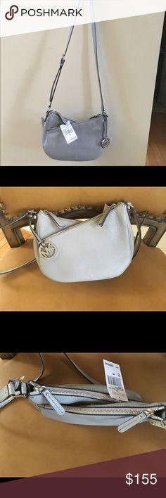 New Michael Kors LEA Crossbody Pearl Grey Brand new super cute Michael Kors bag $268, pebbled leather, pearl grey, rare!! 100% authentic. Measurements: 10x7x3 MICHAEL Michael Kors Bags Crossbody Bags